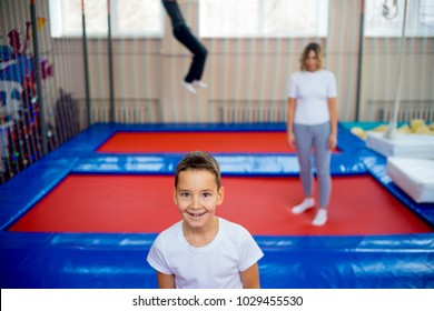 Family in trampoline center