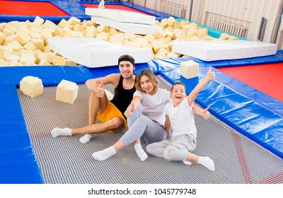 Family in trampoline center