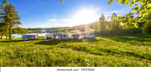 Family travel concept. Caravans and camping on the lake.