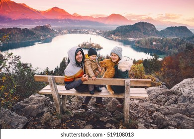 Family travel Europe. Bled Lake at autumn or winter time, Slovenia, Europe. Top view on Island with Catholic Church in Bled Lake with Castle and Mountains in Background.