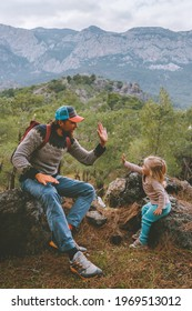 Family travel father and daughter baby high five hands hiking in mountains together summer vacations adventure healthy lifestyle outdoor Lycian way in Turkey