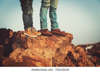 family travel- father and son hiking boots in mountains