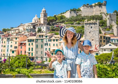 Family travel in Ilaly. Happy family from Mother and two child in Porto Venere sityscape. La Spezia, liguria, Italy.