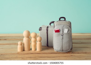 Family travel or travel insurance concept with wooden  figures.