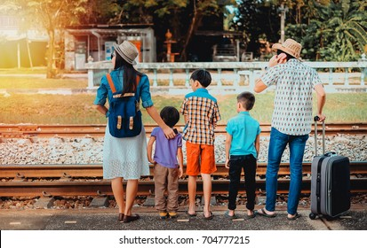 family traveler  looking for train coming on vacation.man woman and children waiting for the train come on vacation.transportation concept.