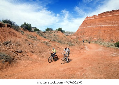 Family traveling by bike along the trail.. Palo Duro Canyon State Park, Texas, US