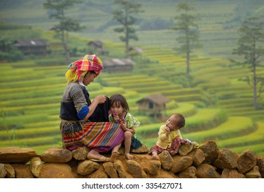 Family tribal mother and children girl smile in rice terraces