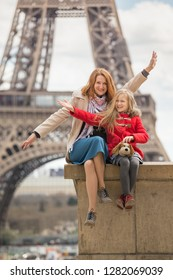 family trip. Happy mom and daughter on the background of the Eiffel Tower in Paris. France