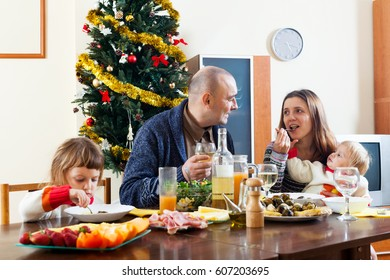 Family with two children  celebrating Christmas  over celebratory table