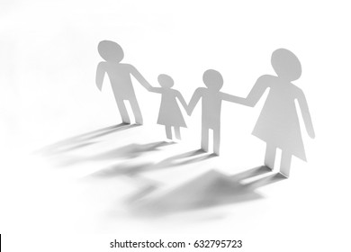 Family with two children, paper figures on a white background