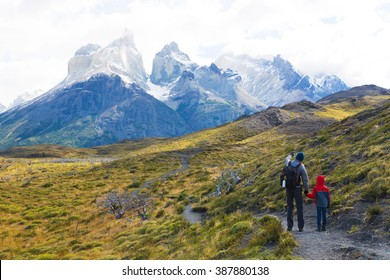 family of two, father and son, enjoying hiking in torres del paine national park, patagonia, chile
