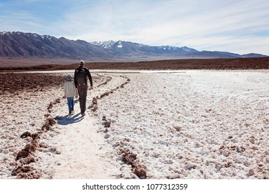family of two, father and son, walking and hiking in lagunas escondidas, secret lagoons, in atacama desert, chile - driest place on earth, family adventure concept