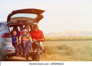 family with two kids travel by car in mountains