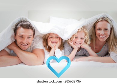 Family under the cover against blue heart