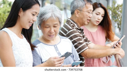 Family using cellphone together