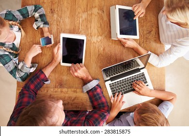 Family using new technology, overhead view