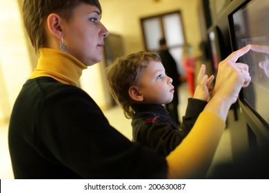 Family using touch screen in a museum