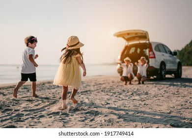Family vacation holiday, Happy family running on the beach in the sunset.Children are running to their parents behind cars.