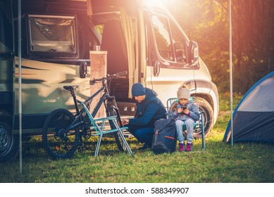 Family Vacation with Motorhome. Family on the Campsite. Recreation and Fun Concept.