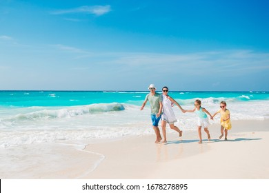 Family vacation. Parents with kids on the beach
