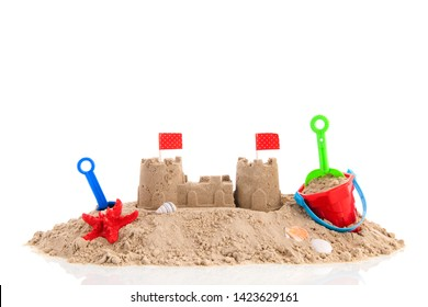 Family vacation with sand castle toys on summer beach isolated over white background