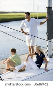 Family vacation together on sailboat on sunny day, on Florida intracoastal waterway
