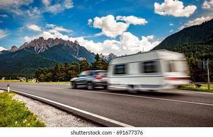Family vacation travel, holiday trip in motorhome, Caravan car Vacation. Beautiful Nature Italy natural landscape Alps.
