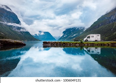 Family vacation travel RV, holiday trip in motorhome, Caravan car Vacation. Beautiful Nature Norway natural landscape.