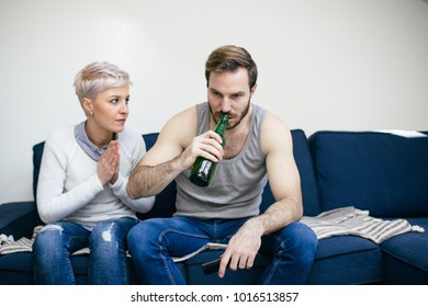 Family violence - aggressive and nervous man arguing with his wife.