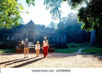 Family visiting ancient Preah Khan temple in Angkor Archaeological area in Cambodia
