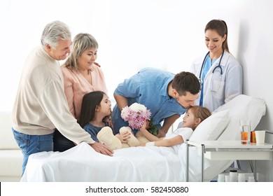 Family visiting little girl in hospital