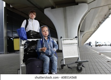 Family waiting taxi transfer at the airport in autumn