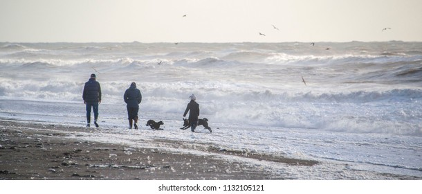 Family walk along a stormy beach