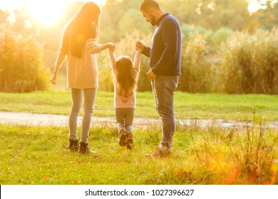 Family walk in the park, happy at sunset