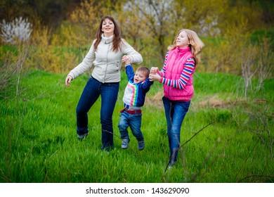 Family walk in the spring garden