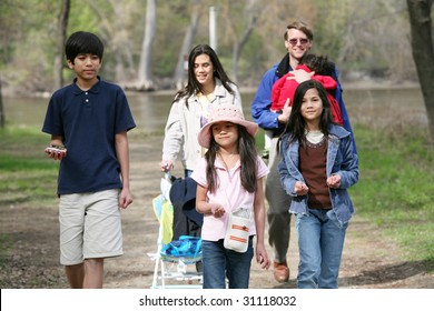 Family walking along quiet country path