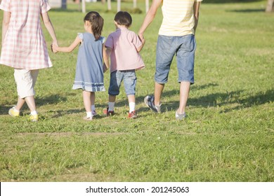 The family walking the camping site