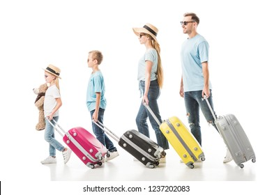 Family walking with colourful luggage isolated on white