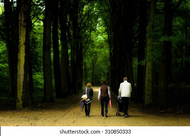 Family walking at the forest on the afternoon