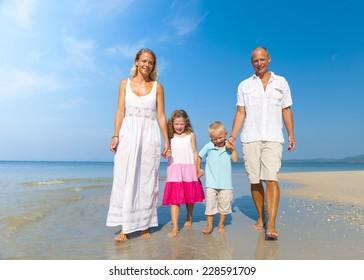 Family walking on beach.