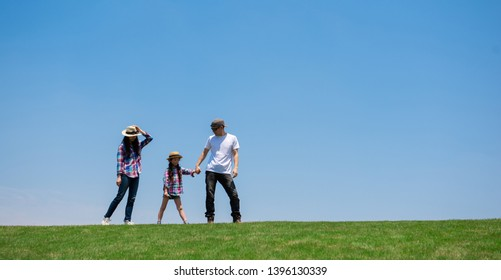 Family walking on the meadow