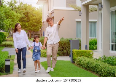 family walking on the model new house looking for living life future, new family meet new house