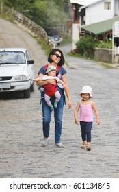 family walking on road in village