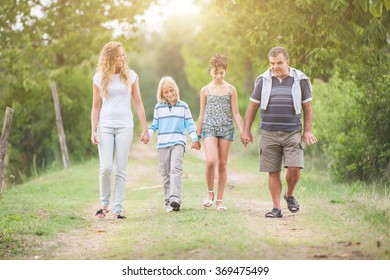Family walking in the summer park