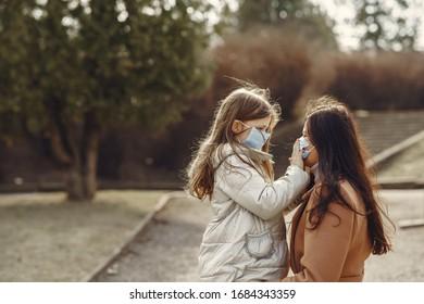 Family walks outside. Coronavirus theme. Mother with daughter.