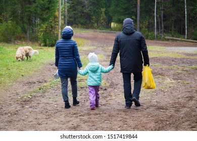 The family walks in the Park together. Carrying out the day off.
