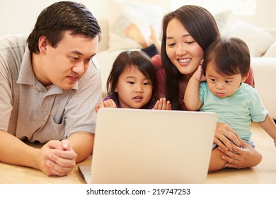 Family Watching Movie On Laptop At Home