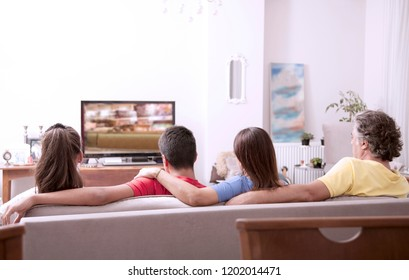 family watching tv at home