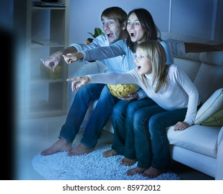 Family watching TV .True Emotions