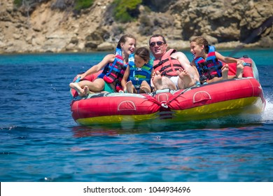 Family water sport adventure on the sea